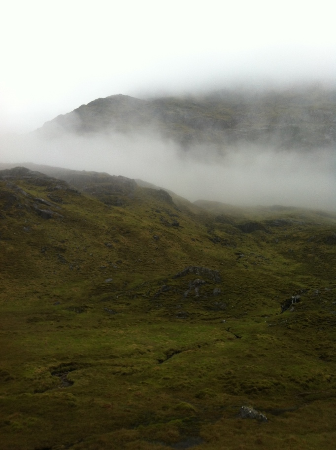 Mountains swirling out the mist at the top of the bealach